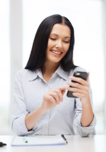 education, school, business, communication and technology concept - smiling businesswoman or student with smartphone texting